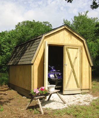 Image of freshly built shed with off road vehicle inside