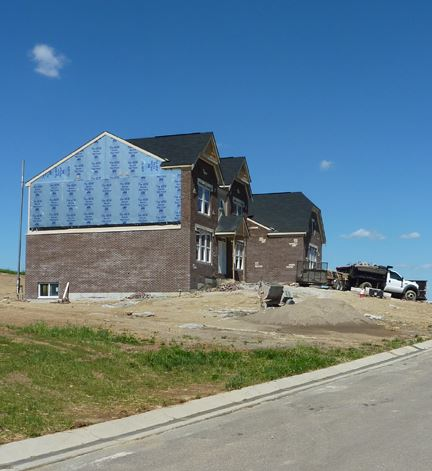 Large home being worked on during construction phase